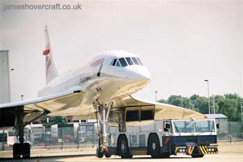 About me - Concorde G-BOAG being taxiied behind the BA engineering workshops at London Heathrow Airport (James Rowson).