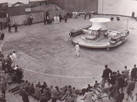 The SRN1 being manufactured - The first flight of the SRN1 on the concrete slipway at East Cowes. The astonished crowd of photographers and journalists would have seen nearly a foot of air beneath the craft during its hover. Note the ground wheels attached to the four corners of the craft (Peter Insole).